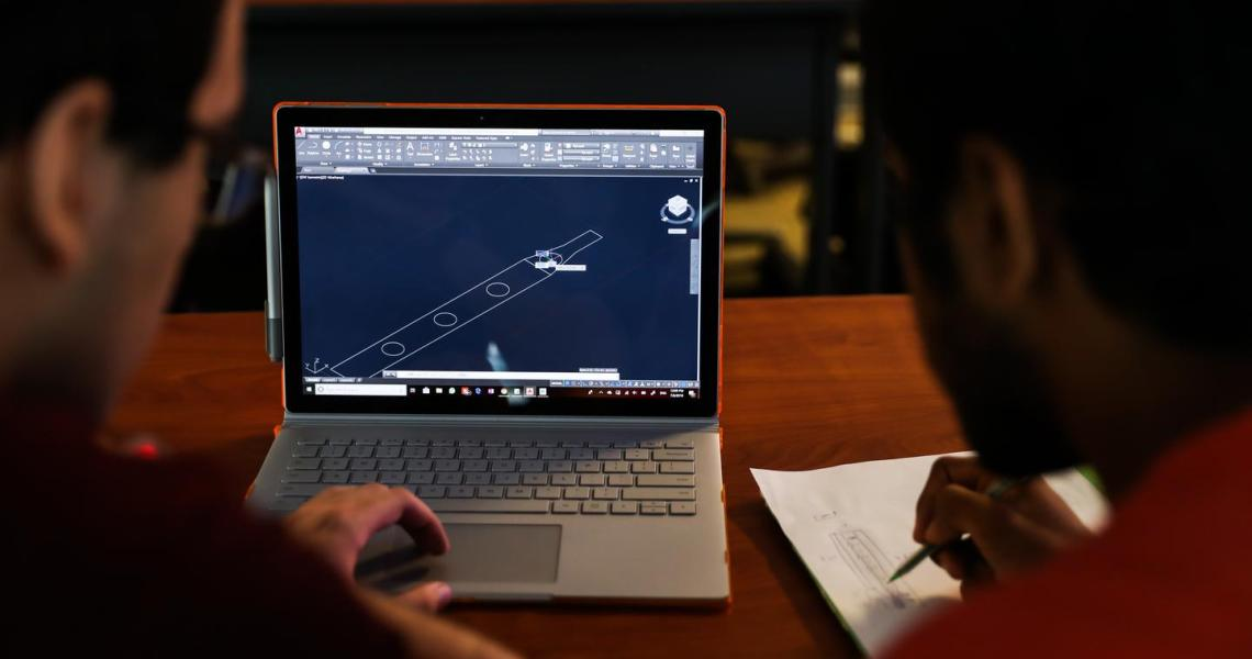 Students participating in the Honors Summer Research Institute produce a 3D CAD model.