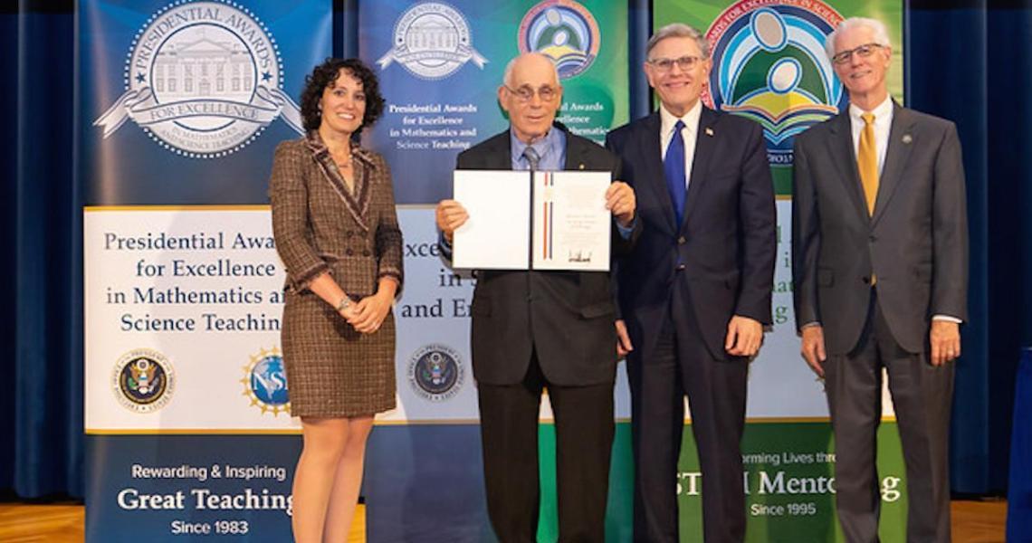 Howard Kimmel, NJIT professor emeritus, accepts his PAESMEM award.