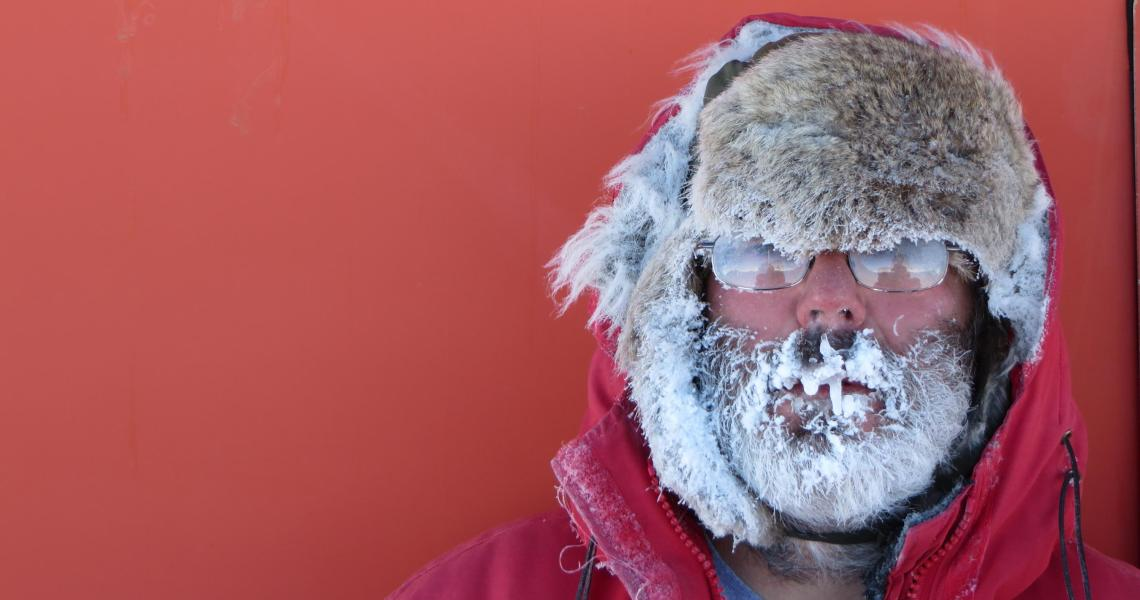Abominable engineer, Gil Jeffer, after shoveling his way through a snow drift to gain entrance to one of the remote instrumentation observatories, last visited four years ago.