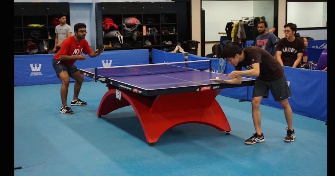 Vivek Kanakamedala (left), an engineering management graduate student, established a Highlanders table tennis team.