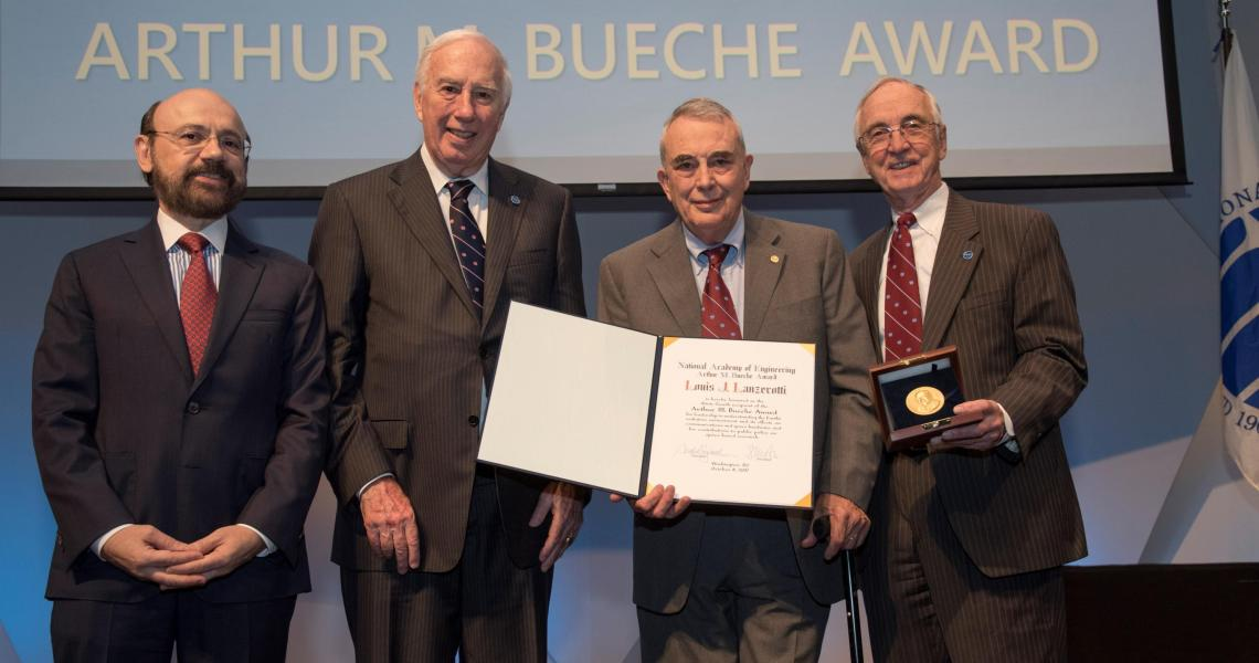 Louis Lanzerotti receiving the Bueche award from the NAE