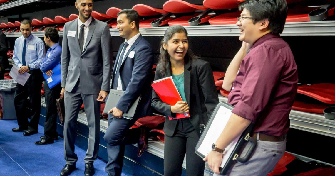 students smiling at a campus career fair