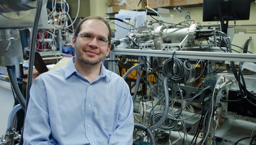 Assistant Professor Alexei Khalizov with instrumentation he is developing to study atmospheric mercury contamination.