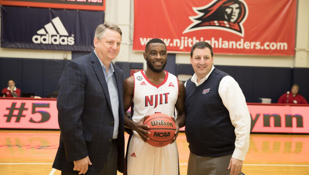 Highlanders senior Damon Lynn sinks the three-pointer that sets the NJIT all-time career scoring record (all levels) at 2,030, passing the previous mark of 2,028 held by Clarence Pierce '96 (D-II).