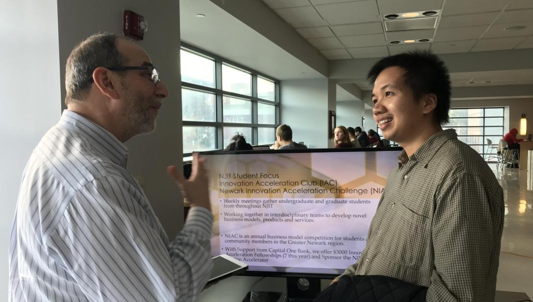 SOM professor Michael Ehrlich and a graduate student