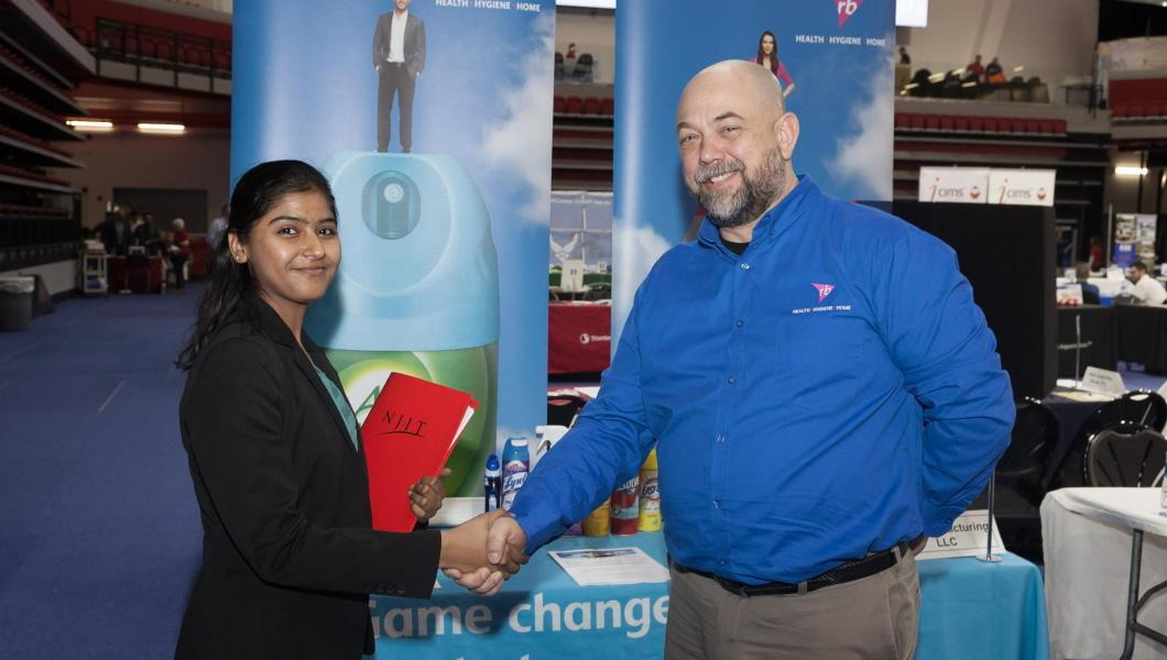 Student Eshita Shah meets with a recruiter at the Spring 2018 Career Fair.