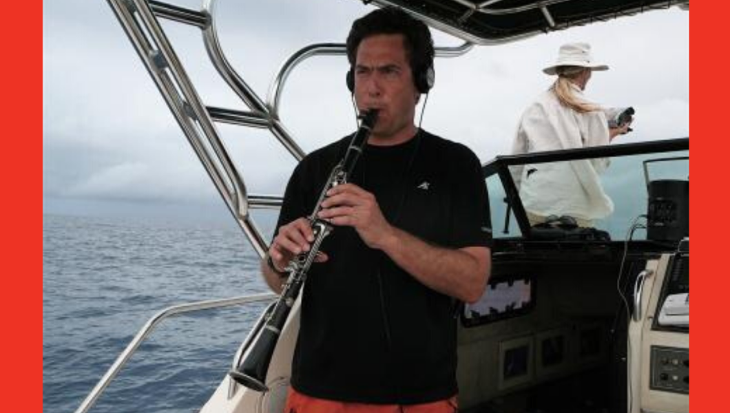 David Rothenberg playing music on a boat