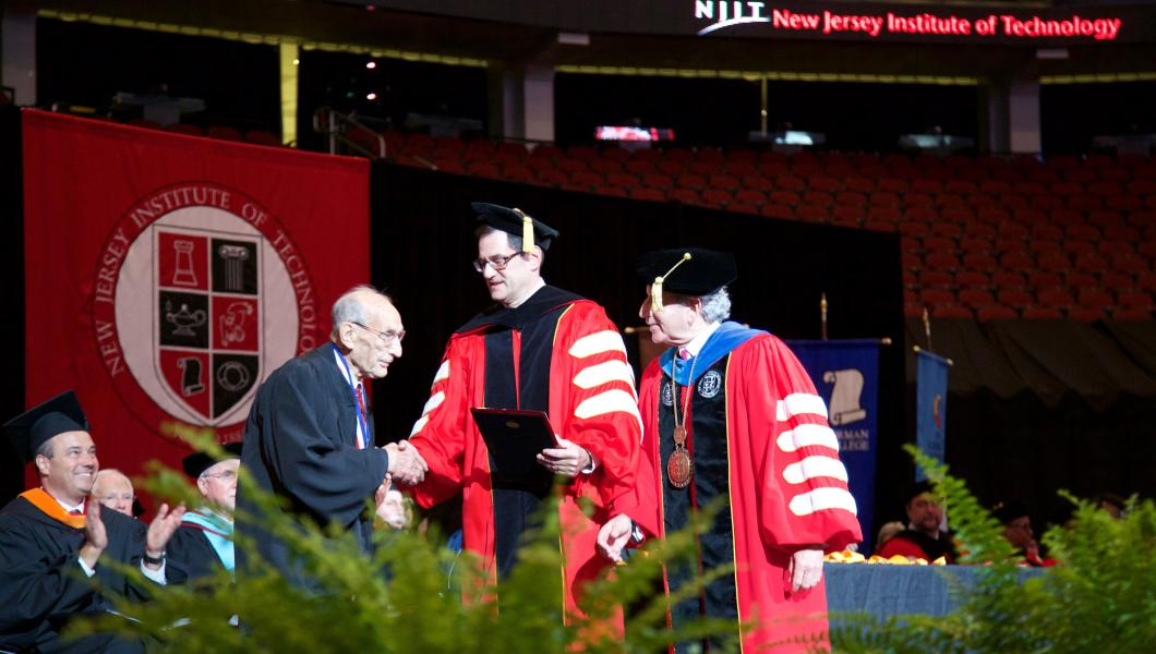 "At NJIT's 2017 commencement, Herman Blackman received a special award for ""most senior alumnus."""