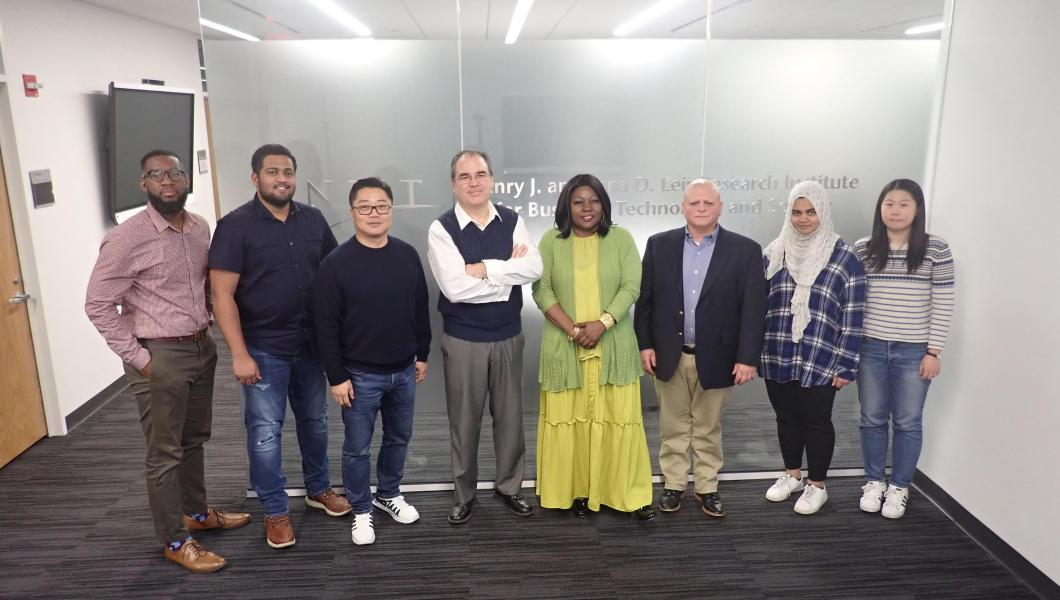 Associate Professor of Entrepreneurship Cesar Bandera (fourth from left) with Entrepreneurial Strategy students (from left) Gary White, Araviind Krishnaraj, Yujae Yi, Rita Tabe, James Colonias, Hana Sherza and Yiting Zhu