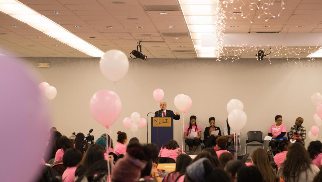 President Bloom addresses attendees at the Girl Power Summit.