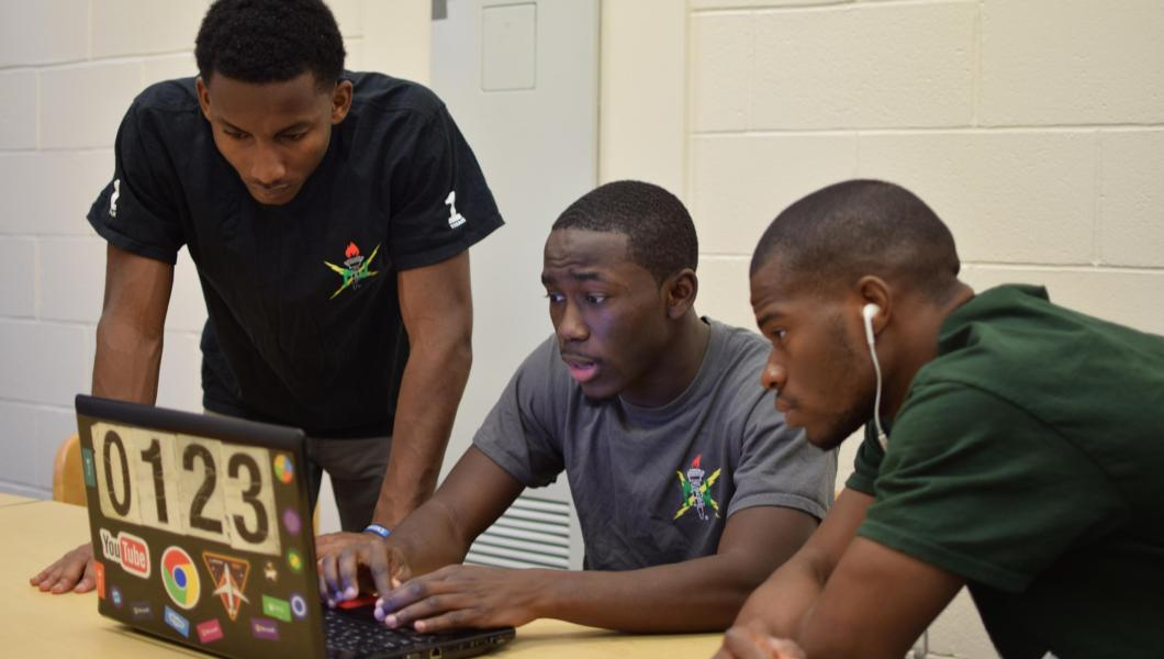 Norman Hamilton (center), internal vice president of the NJIT chapter of NSBE, collaborates with Angel Plaza (left), external vice president, NSBE, and Emmanuel Dortu, assistant secretary, African Student Association NJIT chapter, on designing the NSBE we