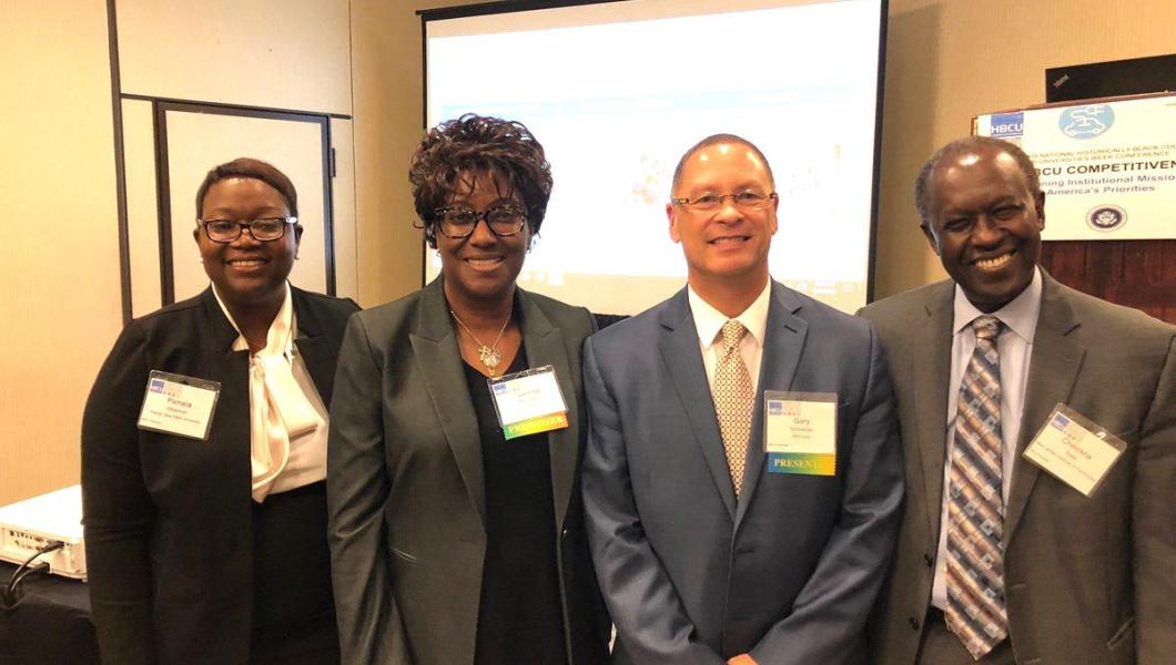 At the HBCU conference (from left) Pamela Obiomon, Prairie View A&M University; Valinda Kennedy, IBM-Midwest; Gary Schneider, IBM; Cheickna Sylla, NJIT