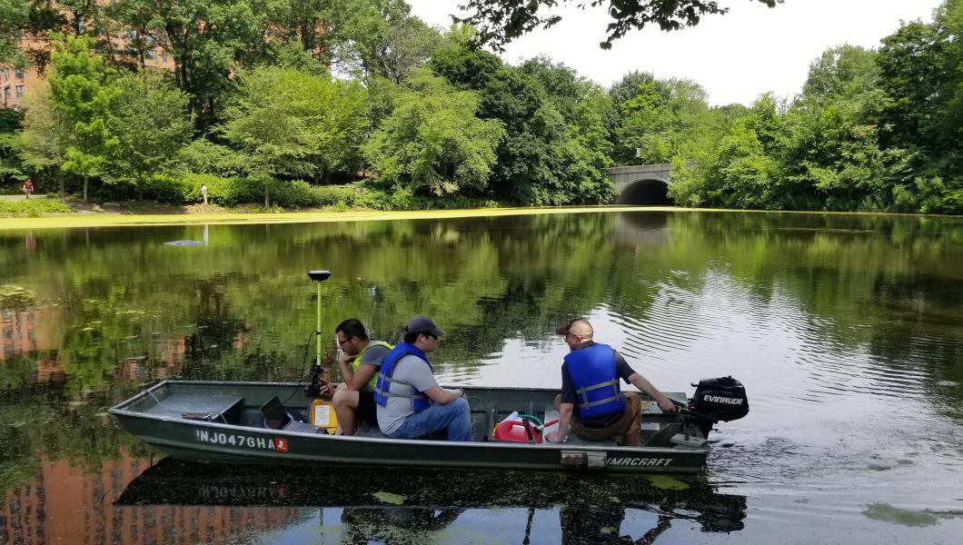 Surveying engineering technology students and Bert Wyness, instructor, traverse the lake in Newark's Branch Brook Park to perform a bathymetric survey.