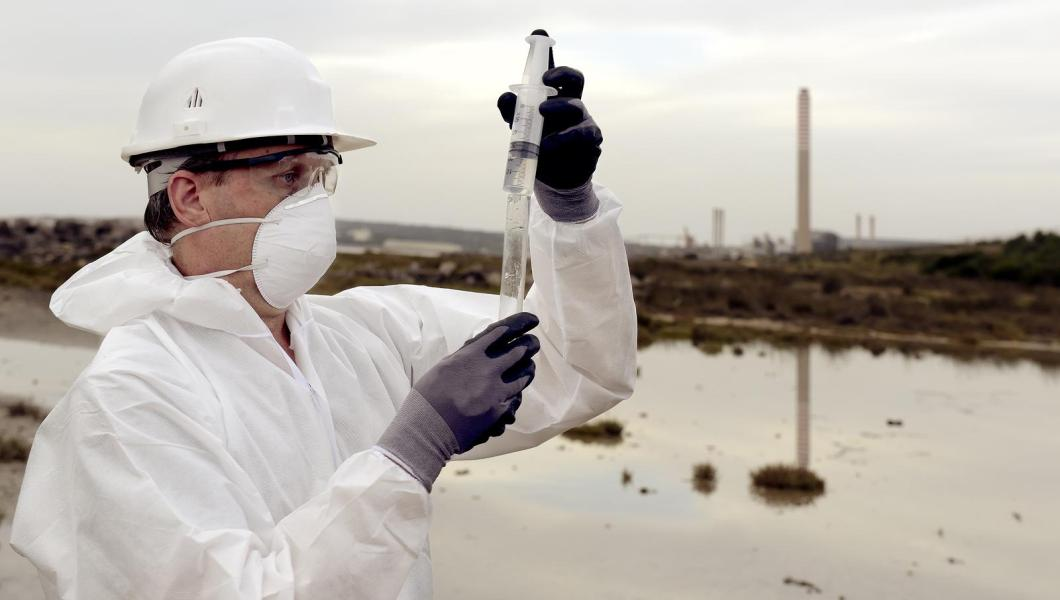 Technician in protective suit