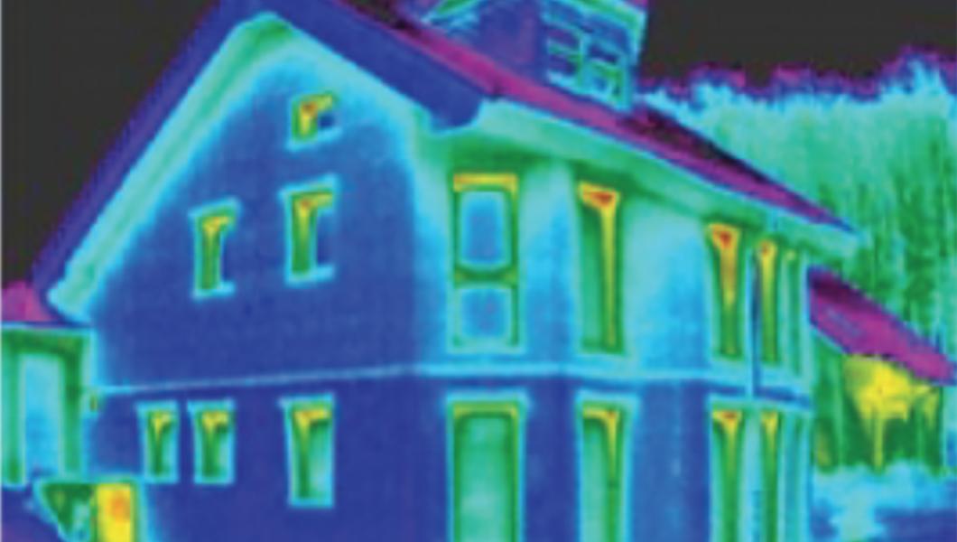 Infrared (IR) image of well insulated house showing minor leakage of heat near the tops of windows.