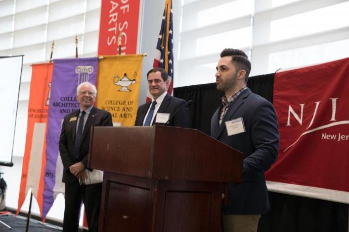 Stephen Najemian (at podium) thanked CDS for naming Prudential Most Engaged Partner, as Martin Tuchman School of Management Dean Reggie Caudill (far left) and Steven B. Saperstein '84, a member of NJIT's Board of Overseers and a Prudential COO, looked on.