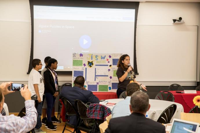 Middle schoolers participating in the Bernard Harris Summer STEM Camp gave a presentation about jigsaw puzzles in space to STEM forum attendees.