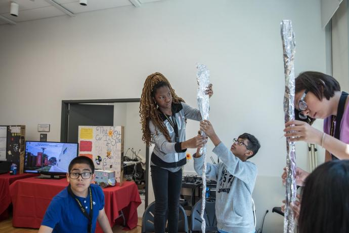 """The day's hands-on activity had campers constructing """"space elevators"""" out of aluminum foil."""