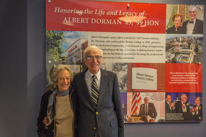 Joan and Albert Dorman in front of the placard highlighting many of his accomplishments.