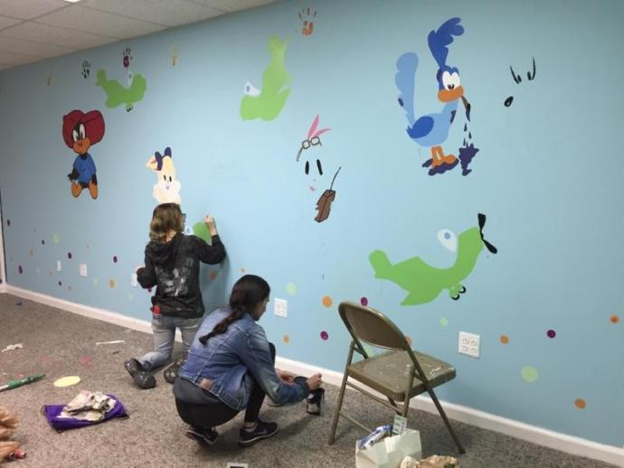 During Alternative Spring Break 2018, NJIT students painted a mural at the Bessie Mae Women and Family Health Center in East Orange, N.J.