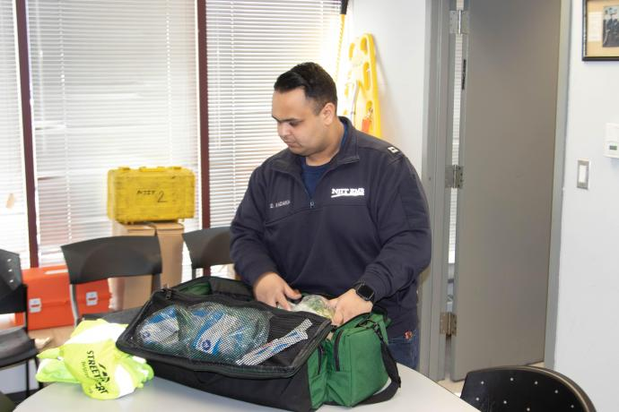 As part of his student EMT duties, Dhwanil Kadakia checked the EMT supplies bag.