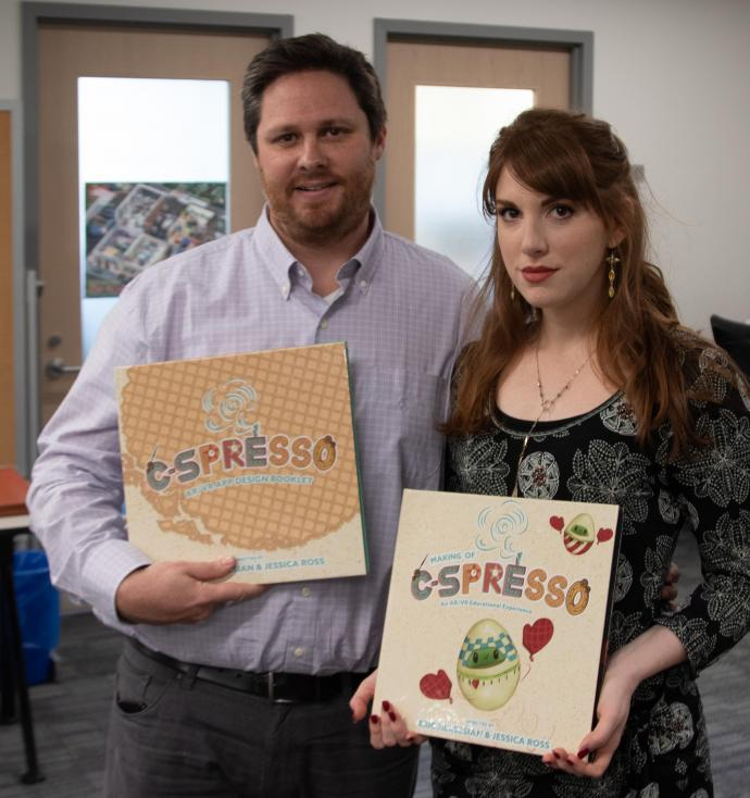 Nersesian and design professor Jessica Ross show their book for an augmented reality project