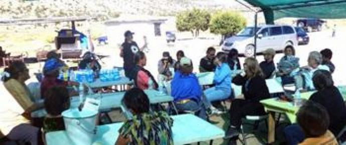A community meeting near a uranium mine