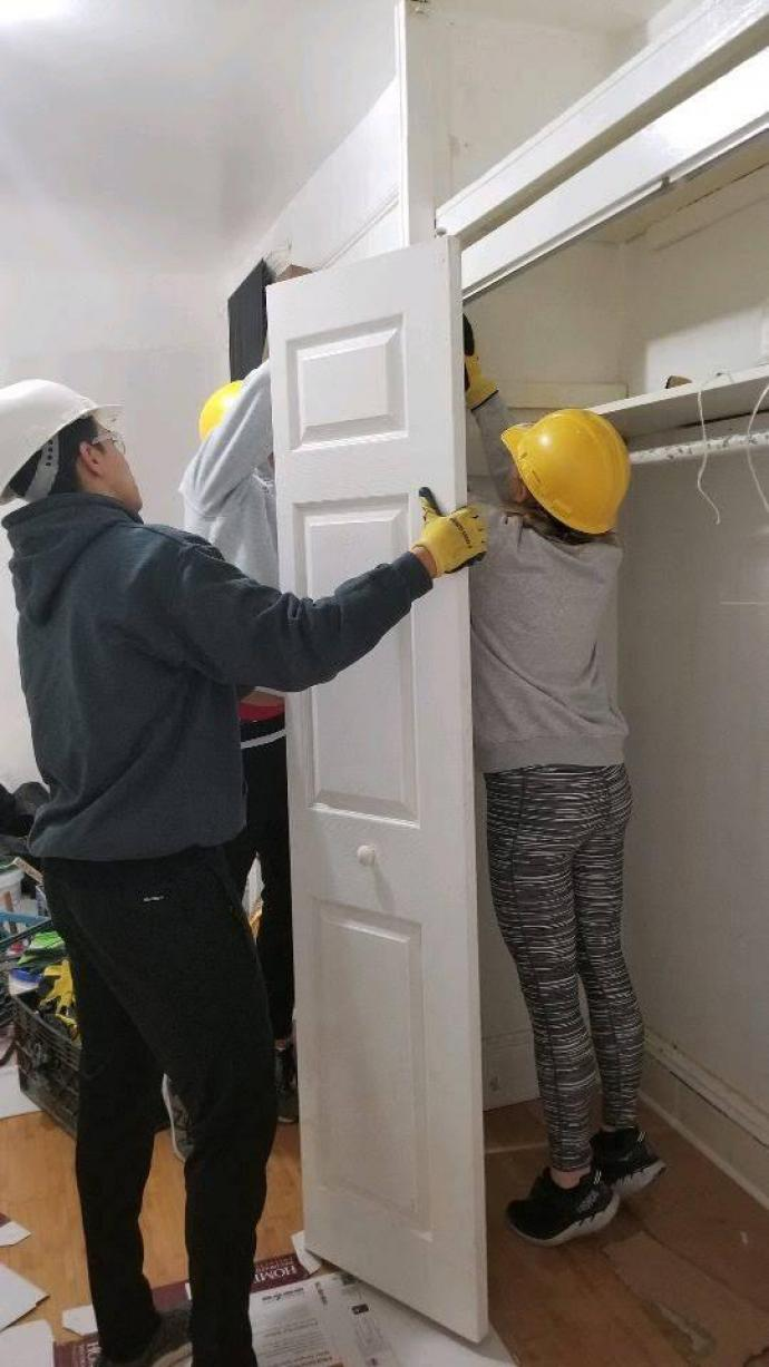 (Top and bottom) Habitat for Humanity Newark had NJIT students painting baseboards, caulking windows and hanging a door at a home in Jersey City.