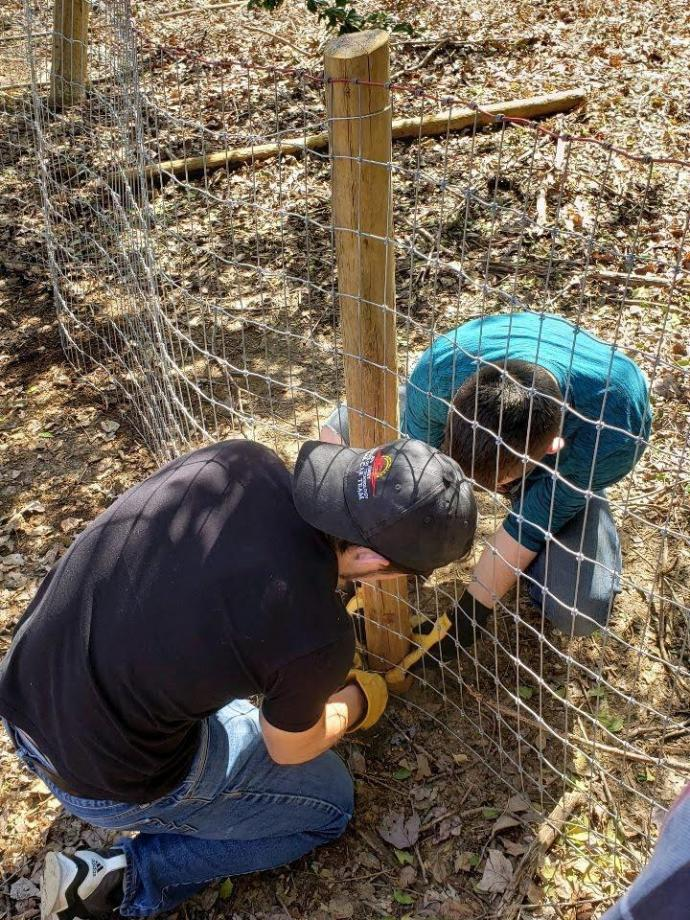 (Top and bottom) NJIT students helped install livestock fencing at OASIS tlc, which operates a farm for young adults with autism to learn animal care, horticulture and other vocations.