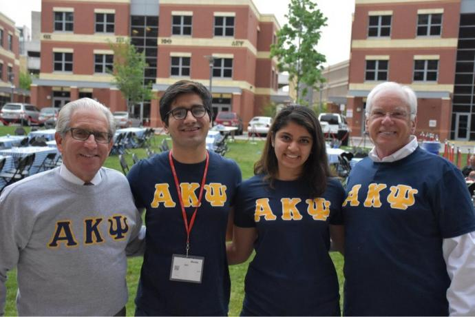 NJIT President Joel Bloom (left) and MTSM Dean Reggie Caudill (right), Alpha Kappa Psi honorary members, pose with Awais Qazi, founder and former president, and Mansha Kohli, current president (center).