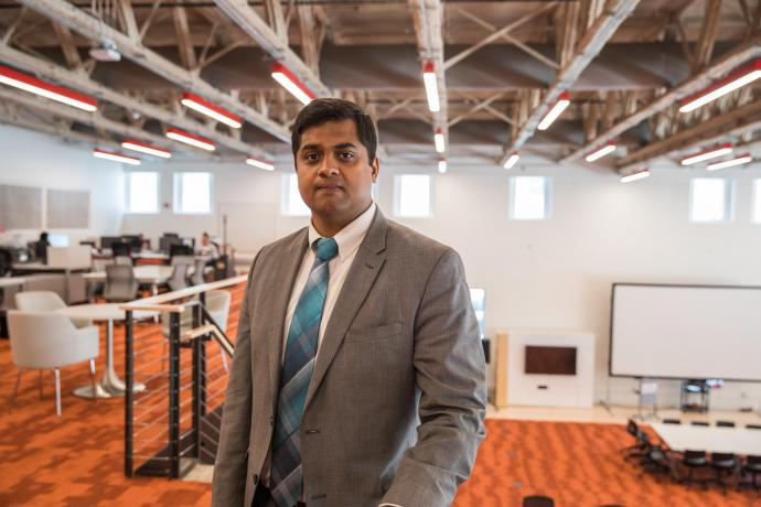 Balavignesh Thirumalainambi poses in the Agile Strategy Lab inside of Central King Building