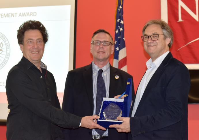 David Rothenberg, distinguished professor of humanities (left) and Dr. Kevin Belfield present Benson with the Kappraff Award for Excellence in Science and Arts.