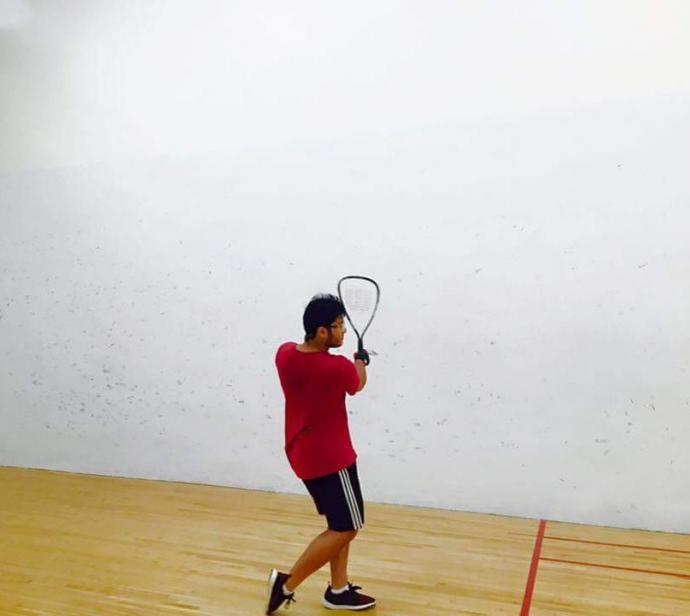 Khode hits the racquetball court.