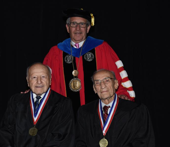 Golden Highlanders Joseph Messina '47 (left) and Herman Blackman with President Joel S. Bloom.