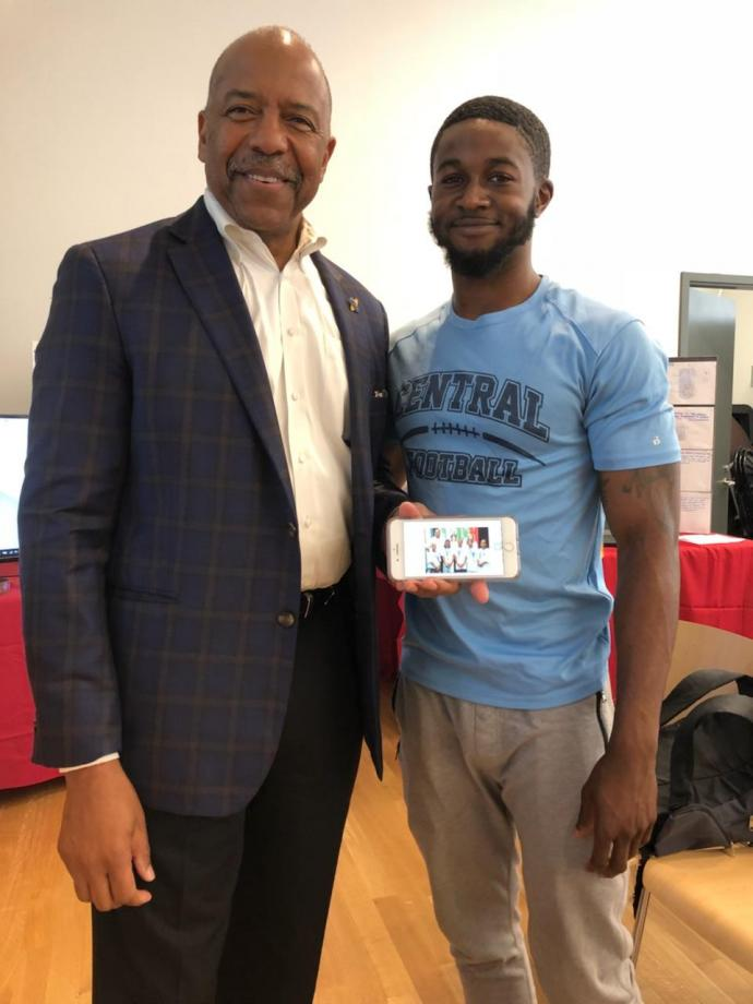 (Top and bottom) NJIT and Pre-College alumnus and former BHSSC camper Damilola Ojoye reconnects with Dr. Bernard Harris.