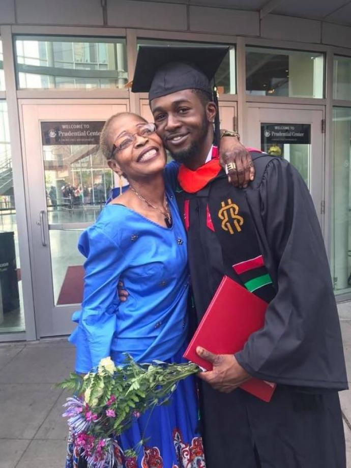 Damilola Ojoye '18 gets a congratulatory hug from his mother at commencement.