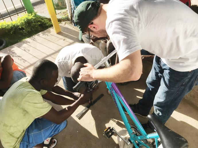 Shortly after arriving in Milot, the NJIT Engineers Without Borders team begins assembling the student-designed cellphone charging device, known as the Light Cycle, at the taxi station designated by the villagers to house it.