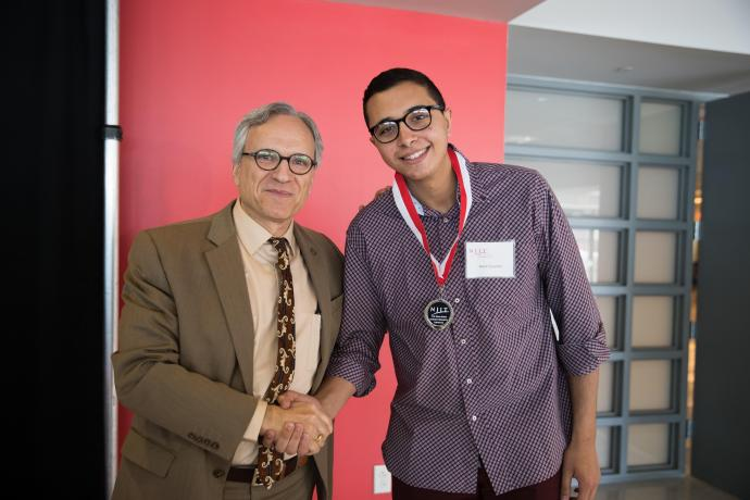 NJIT Provost and Senior Executive Vice President Fadi P. Deek awards Elzomor for his work at the 2018 Dana Knox Student Research Showcase.