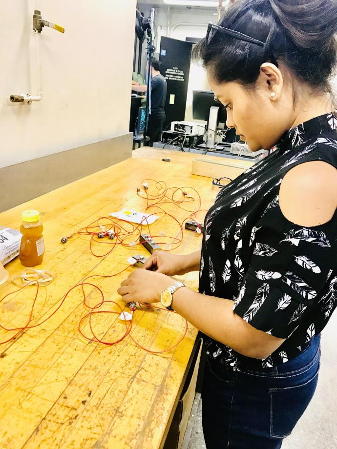 Doctoral student Gayani Gunarathna, who gleaned valuable insights from the Ph.D. Professional Development Series, prepares acoustic emission sensors for a hydraulic fracturing test.