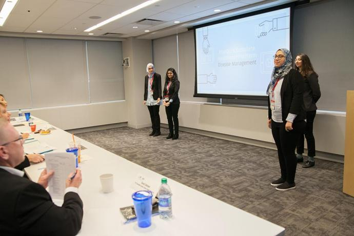 The RiseOn team presents to the judges at the Health Care Transformation Challenge.