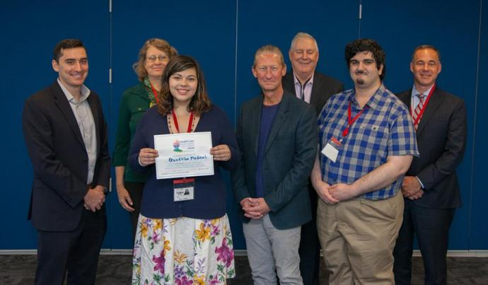 Kaila Trawitzki (third from left) and Mert Nacir (sixth from left) placed second in Horizon BCBSNJ's Health Care Transformation Challenge. With them are judges (from left) Craig Limoli, Kathleen O'Brien, Douglas Blackwell, Allen Karp and Chad Forbes.