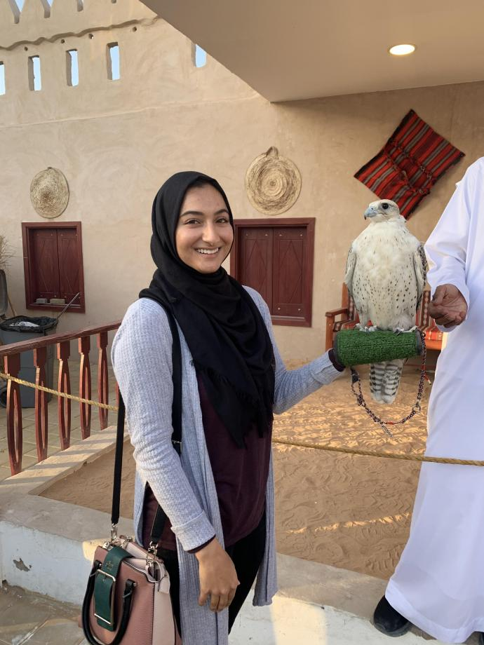 At the Sheikh Zayed Festival with a falcon, the UAE national bird