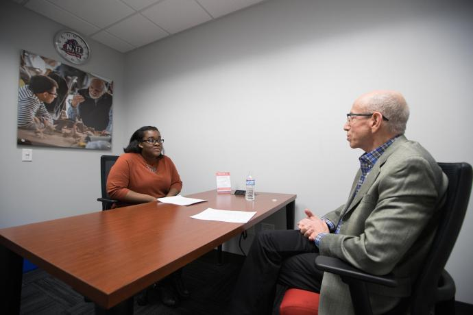 Alum John Decker meeting with a student at the CDS office.