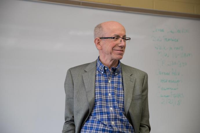 John Decker speaking to astronomy class.