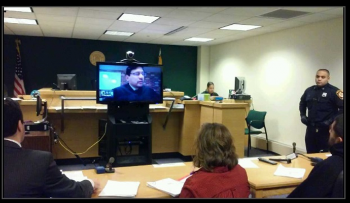 Judge Mohammed appearing remotely by Skype in his courtroom.