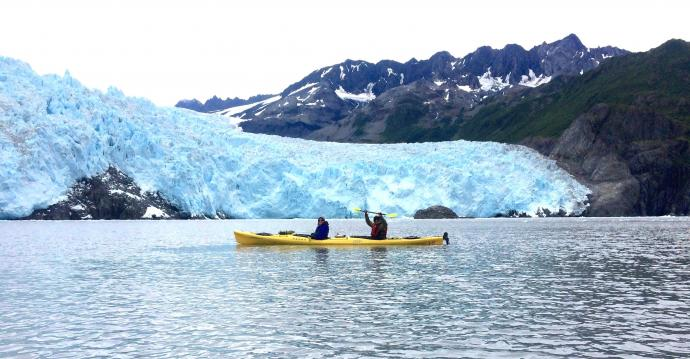 Assistant Professor Raja Roy and his wife kayaking at Aialik Glacier at Kenai Fjords National Park.