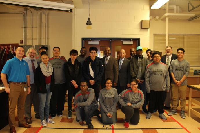 Mayor Eric E. Jackson (center) of Trenton with the Build It Better Design Challenge judges, organizers and student participants.