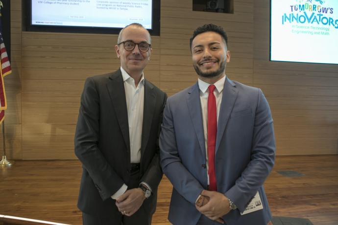 NJIT student Nick Fuentes-Zuluaga with Bristol-Myers Squibb CEO Giovanni Caforio