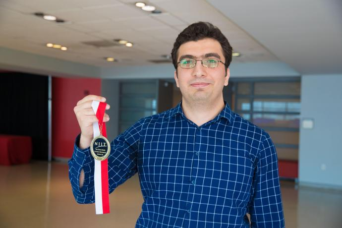 Najmaddin Akhundov presents his first-prize graduate student researcher medal at the 2018 Knox Student Research Showcase.