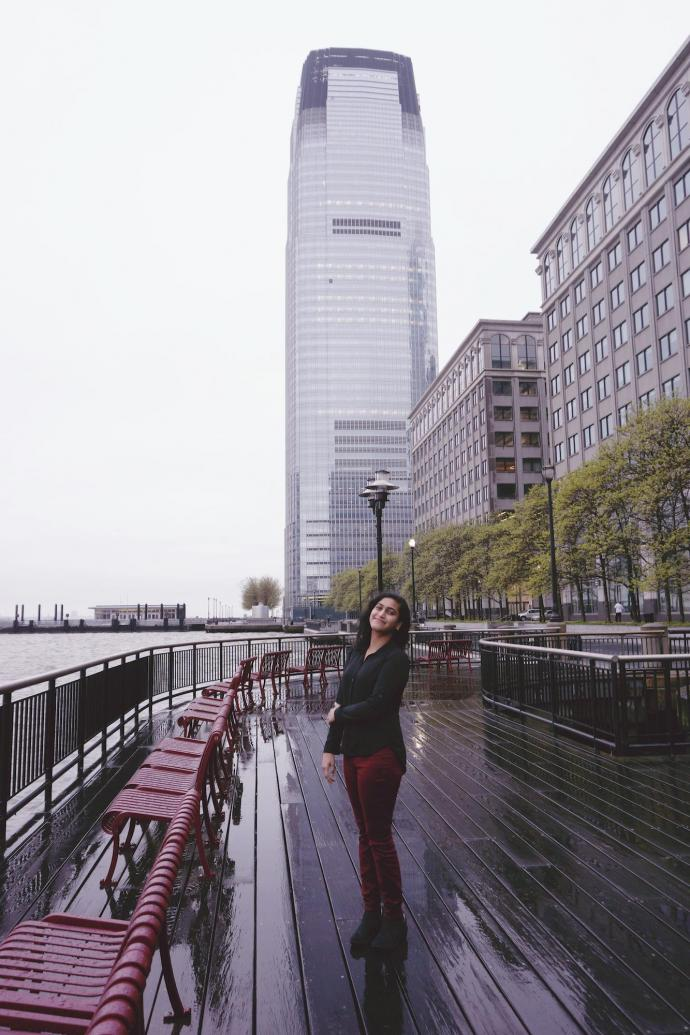 With the Goldman Sachs tower in the distance, Priya Ravi was all smiles in the neighborhood where she'll officially begin her career.